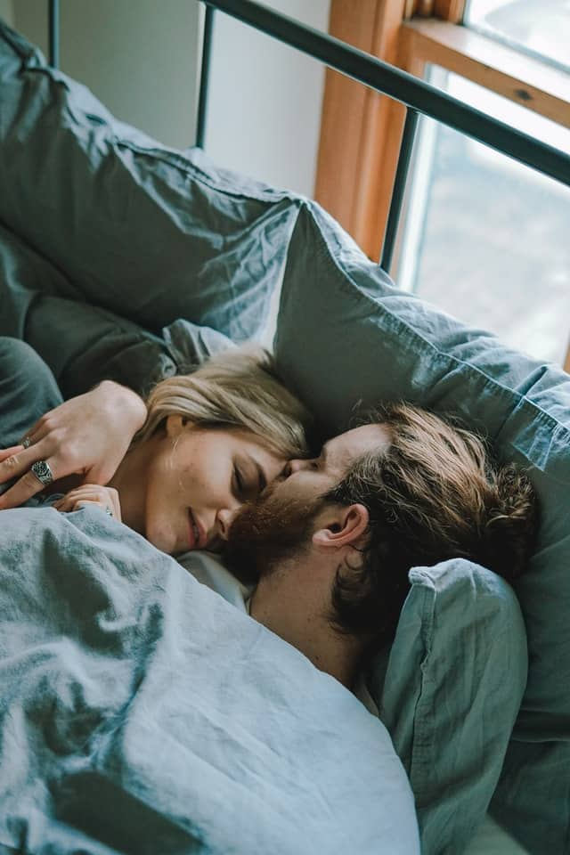 cuddling in bed is a great way to attract your man
