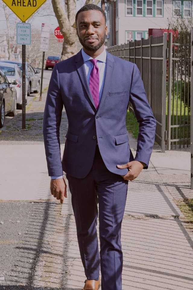 Wearing a designer suit can help tremendously with creating a masculine look